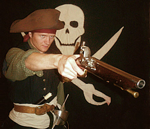 dane dressed up as a pirate, with a hat and gun and sword and everything!
