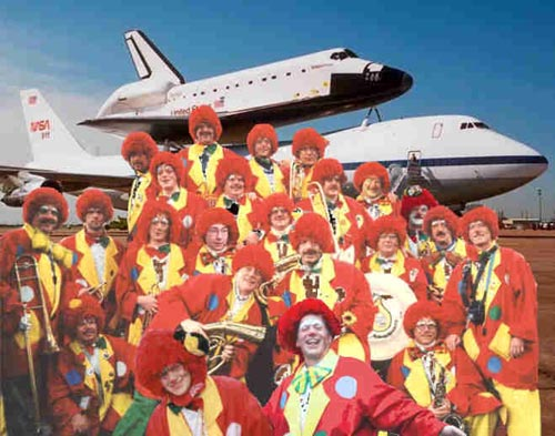 Clowns in front of... uhh... the space shuttle...